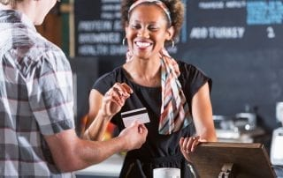 Small business owner accepting a credit card payment